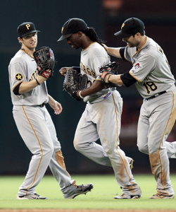 Andrew McCutchen (center) and the Pirates deserve a pat on the back for their solid play in the first half. (Getty Images)