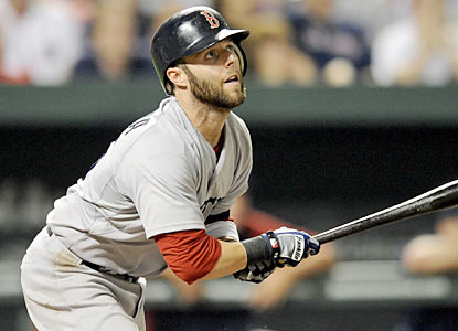 Dustin Pedroia helps spark a massive rally in the eighth that breaks up a tie game for Boston. (AP)