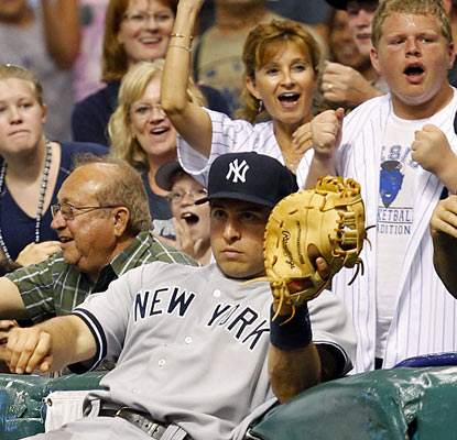It's not the easiest way to end a game, but Mark Teixeira makes it happen with this catch in foul territory.  (AP)