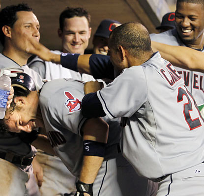 Lou Marson gets plenty of love from his teammates after he provides a tiebreaking homer in the seventh.  (AP)