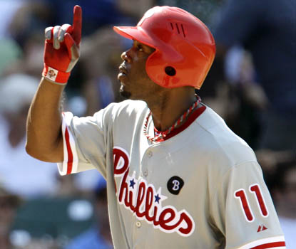 Jimmy Rollins celebrates his second homer in Philly's romp over the Cubs. It's Rollins' seventh career multi-homer game. (AP)