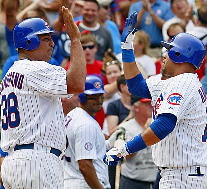 Carlos Zambrano -- who wins for the second time since May -- congratulates Aramis Ramirez on his fifth-inning homer. (AP)