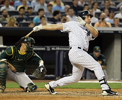 Mark Teixeira takes it out of the park with the bases loaded in a nine-run third inning. (Getty Images)