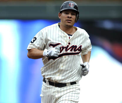 Danny Valencia's solo homer stakes the Twins to an early 2-0 lead; he later scores again on Delmon Young's double. (Getty Images)