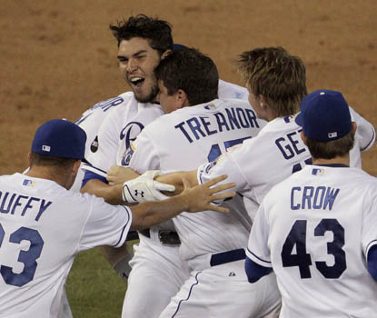 Rookie first baseman Eric Hosmer celebrates with his Royals teammates after his RBI double defeats Tampa Bay in 10 innings. (AP)