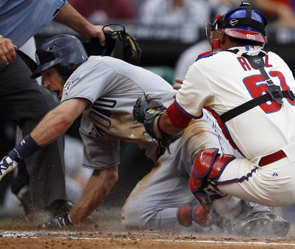Chris Denorfia slides home safely past the tag of Carlos Ruiz, giving San Diego a 3-1 second-inning lead. (AP)