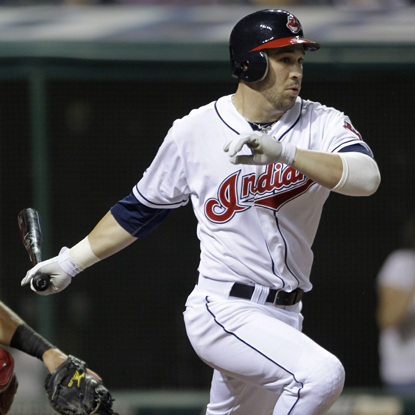 With two outs and the bases loaded in the bottom of the ninth, Jason Kipnis delivers his first career hit.  (AP)