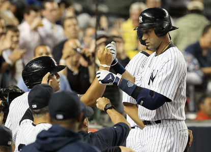 Derek Jeter celebrates a third-inning home run, his first since connecting for hit No. 3000 on July 9. (Getty Images)