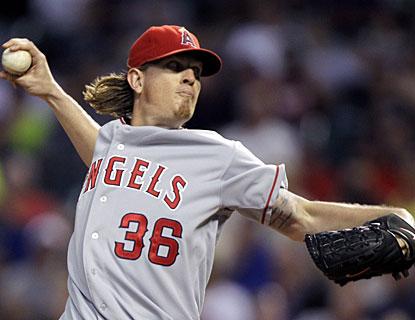 Jered Weaver goes seven strong to lower his ERA to a major-league best 1.79 and earn his 14th win. (AP)