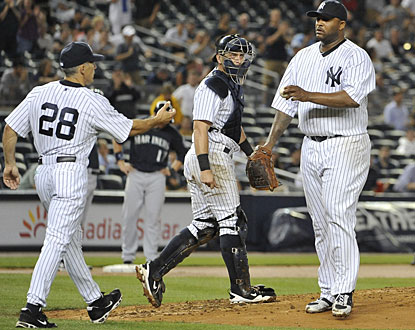 CC Sabathia exits the game in the eighth after striking out 14 of the 25 batters he faces to win his 15th game. (AP)