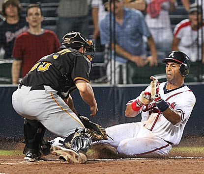 Does Michael McKenry get a tag on Julio Lugo in the bottom of the 19th? Home plate umpire Jerry Meals decides no.  (US Presswire)