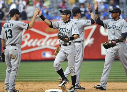 The M's celebrate after taking out 21 days of frustration on New York to end the majors' longest skid since 2005 (K.C.). (AP)