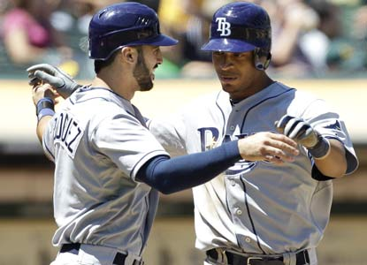 Along with his first career HR, Desmond Jennings has a two-run double in a seven-run seventh to help stun the A's. (AP)