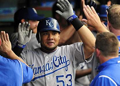 Teammates cheer Melky Cabrera in the dugout after his grand slam shot in the fourth inning. (Getty Images)