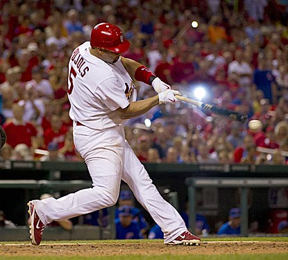 With all of Busch Stadium focused on him, Albert Pujols connects for his milestone hit in the eighth inning.  (US Presswire)