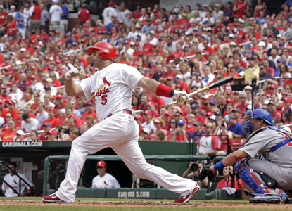 Albert Pujols follows through on the 432nd HR of his career -- a solo shot in the first inning against the Cubs. (AP)