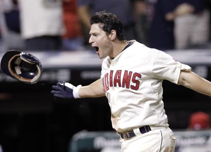 Cleveland's Matt LaPorta celebrates while rounding the bases after his three-run walk-off homer defeats Kansas City. (AP)