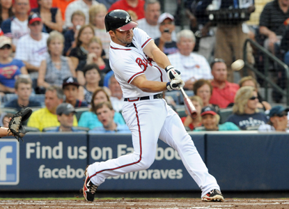 After driving in a three-run shot against the Marlins, Dan Uggla raises his career-best hitting streak to 21 games.  (Getty Images)