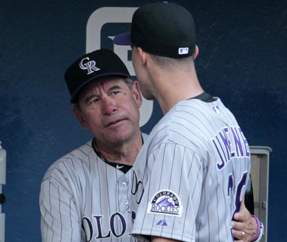 Rockies pitching coach Bob Apodaca speaks with Ubaldo Jimenez after his trade to Cleveland became official in the first inning. (AP)