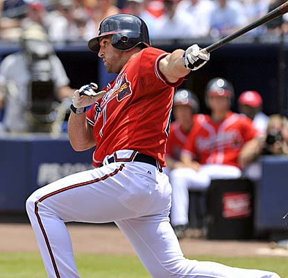 Dan Uggla extends his hitting streak to 22 games as the Marlins hand the Braves their 10,000th loss in franchise history. (AP)