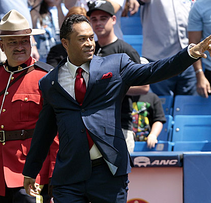 Recent Hall of Fame inductee Roberto Alomar celebrates in Toronto as his No. 12 is retired. (Getty Images)