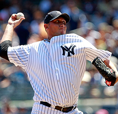 Freddy Garcia wins his 10th game, striking out six in six innings while allowing two runs on five hits. (Getty Images)
