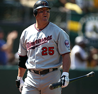 Twins slugger Jim Thome collects three hits vs. the A's, including his 597th home run. (Getty Images)