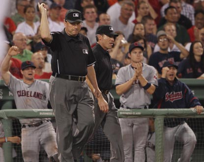 The Indians dugout cheers as umpire Gerry Davis signals a home run for Cleveland's Asdrubal Cabrera following a replay review. (Getty Images)