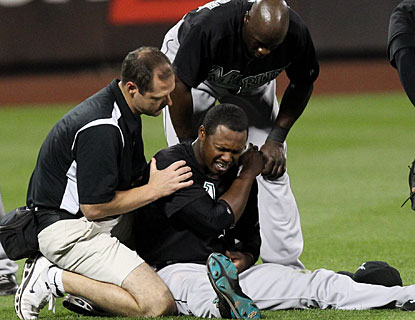 Hanley Ramirez is tended to by medical personnel after injuring his left shoulder diving for a ball. (US Presswire)