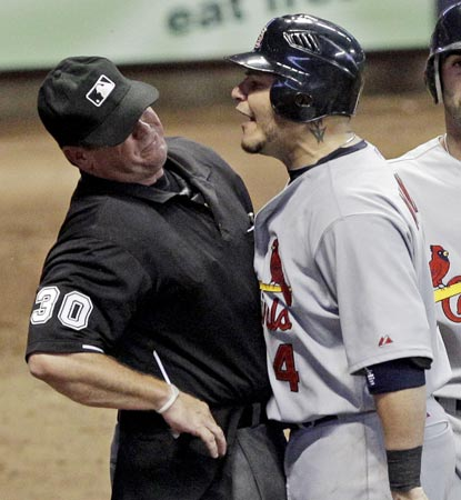 An eventful evening for home plate umpire Rob Drake escalates during an argument with an incensed Yadier Molina.  (AP)