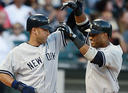 Derek Jeter and Robinson Cano combine for eight hits, six runs and six RBI in the Yankees' rout of Chicago.  (AP)