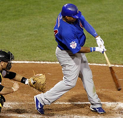 Marlon Byrd's hit scores the go-head run to lift the Cubs to victory, their first four-game sweep in Pittsburgh in 52 years. (AP)