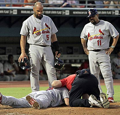 David Freese leaves the game with a mild concussion after being struck in the head by a pitch in the third inning. (AP)