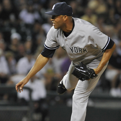 After five relievers combine to throw 4 1/3 innings, Mariano Rivera steps in and earns his 29th save of the season.  (Getty Images)