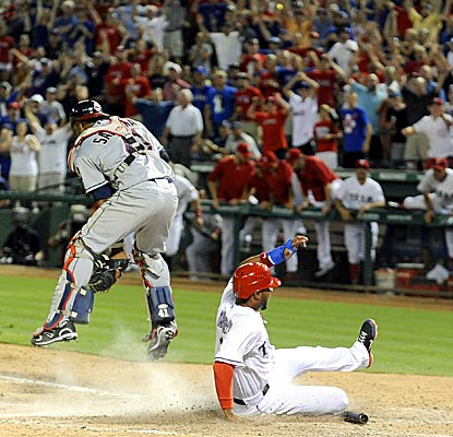Elvis Andrus scores the winning run for the Rangers as they defeat the Indians in extra innings. (AP)