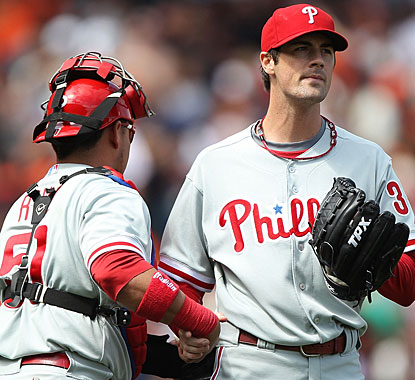 Catcher Carlos Ruiz congratulates Cole Hamels, who takes a shutout into the ninth before settling for the win. (Getty Images)