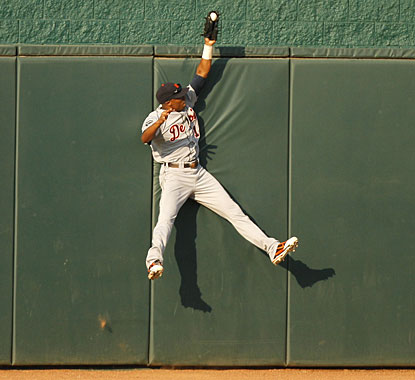 Center fielder Austin Jackson makes a great leap to rob the Royals' Alex Gordon of a home run. (Getty Images)