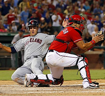 Lonnie Chisenhall beats out the tag at home plate to score the go-ahead run that propels the Indians to victory. (US Presswire)