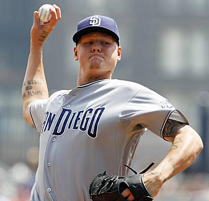 Mat Latos continues the misery for the Pirates by striking out seven batters over seven effective innings. (AP)