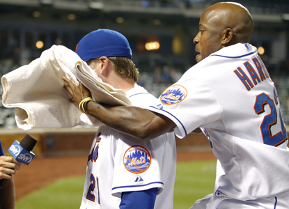 Lucas Duda (left) takes a shaving cream towel to the face after capping a come-from-behind win for the Mets.  (Getty Images)
