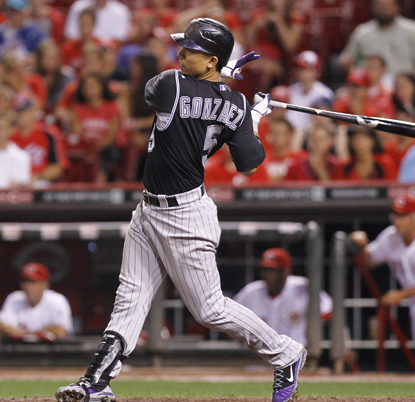 One solid swing is all it takes for Carlos Gonzalez to break an eighth-inning tie and send the Rockies to victory.  (Getty Images)