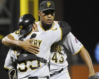 Reliever Jose Veras and catcher Michael McKenry celebrate the end of the Pirates' 10-game losing streak. (Getty Images)