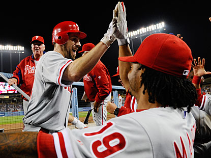 Cliff Lee is cheered in the dugout, not for his win, not for his 10 K's, but for his second career home run. (Getty Images)
