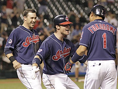 Shortly before 2 a.m., the Indians can finally celebrate after Kosuke Fukudome takes one for the team with the bases loaded.  (AP)