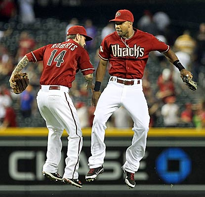 Ryan Roberts (left) and Chris Young celebrate as Arizona takes control of the NL West lead for the first time since June 24. (Getty Images)