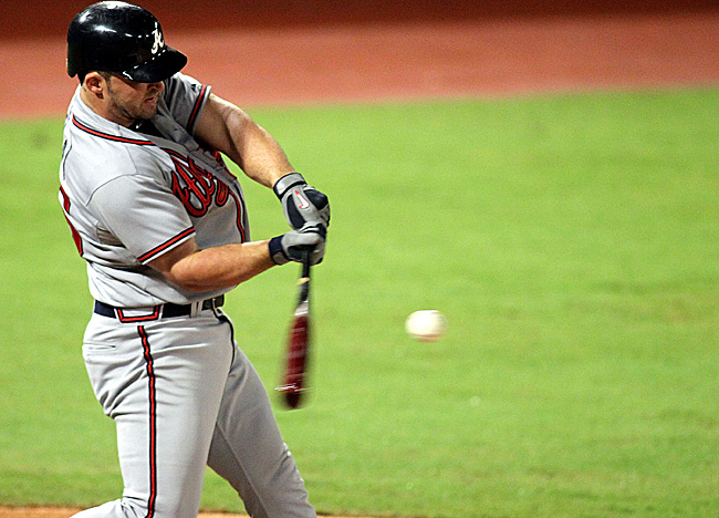 Dan Uggla extends his hit streak to 31 games in his first at-bat vs. Florida on Wednesday. (Getty Images)