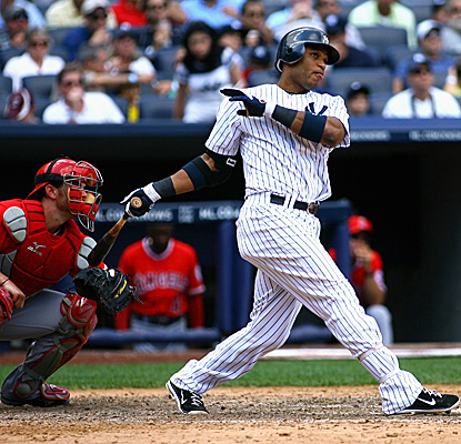 Facing the Angels' Scott Downs, Robinson Cano cracks his fifth career grand slam as the Yankees hold on to win. (Getty Images)