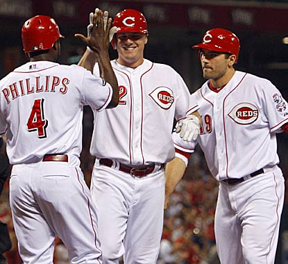 Teammates congratulate Jay Bruce after blasting a three-run shot that eventually led the Reds rally past the Padres. (AP)