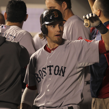 Red Sox rookie Josh Reddick celebrates with teammates after smacking a two-run shot in the sixth inning. (Getty Images)