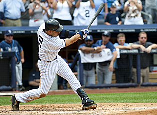 Swinging for his 3,000th career hit, Derek Jeter cracks a home run on July 9 vs. the Rays. (Getty Images)
